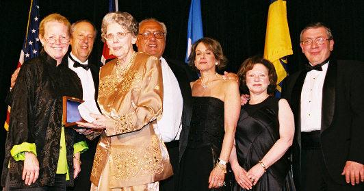Barbara Mueller receiving Philatelic Achievement Award from Shelia Burke; from left to right, Shelia Burke, NPM Director Allen Kane, Barbara Mueller, Event Sponsors Mr. & Mrs. Arthur Morowitz and Mr. & Mrs. Harvey Bennett.